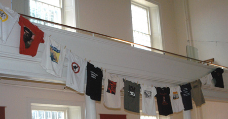 Will's t-shirts hanging at his memorial service.